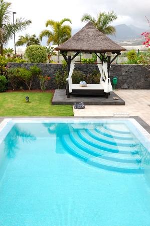 Bali type hut and swimming pool at luxury villa, Tenerife island, Spain