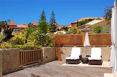 Sunbeds at the outdoor of luxury villa, Tenerife island, Spain