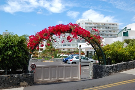 Building and arc with flowers of luxury hotel, Tenerife island, Spain