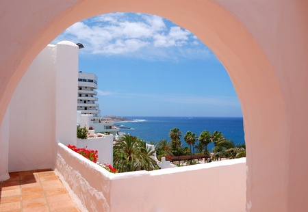 hotel balcony: The sea view from a building of luxury hotel, beach and Atlantic Ocean, Tenerife island, Spain