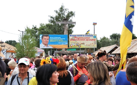 commercial event: VELIKI  SOROCHINTSI VILLAGE, POLTAVA REGION, UKRAINE - AUGUST 20: Crowd of people on the open-air famous National Sorochintsi Fair on August 20, 2011. The Sorochintsi Fair is the most well known Ukrainian cultural and commercial event worldwide. Editorial