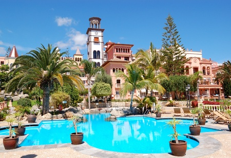Tower with clock and swimming pool at the luxury hotel, Tenerife island, Spain
