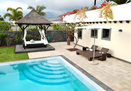 Hut and swimming pool at luxury villa, Tenerife island, Spain