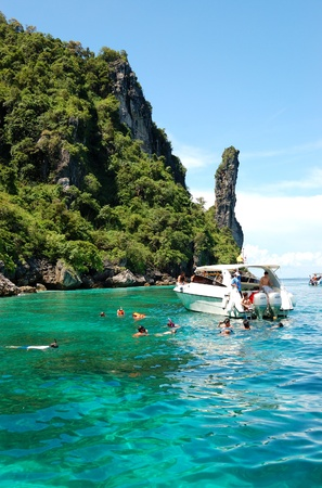 KOH PHI PHI, THAILAND - SEPTEMBER 13: Snorkeling tourists on turquoise water of Maya Bay lagoon on September 13, 2010 in Koh Phi Phi island, Thailand. 15841683 tourists have visited Thailand in year 2010