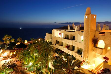 Sunset and building of luxury hotel, Tenerife island, Spain