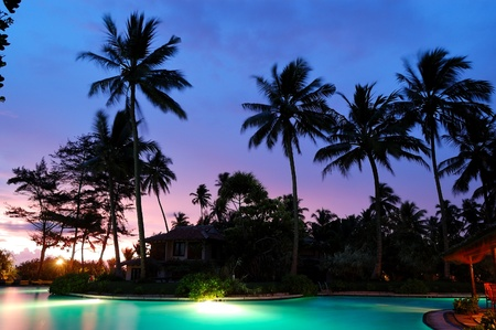 Sunset and illuminated swimming pool, Bentota, Sri Lanka photo