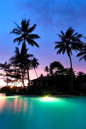Sunset and illuminated swimming pool, Bentota, Sri Lanka