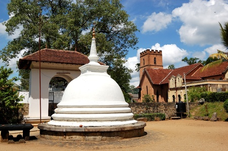 White Stupa at the Temple of the Lord Buddha Tooth Relic.  Kandy, Sri Lanka. The Temple is the Sacred Place for all buddhists in the world. photo