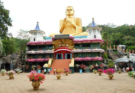 DAMBULLA - OCTOBER 15: The Golden Temple Dambulla. October 15, 2011 in Dambulla, Sri Lanka. The Temple is the UNESCO World Heritage Site.