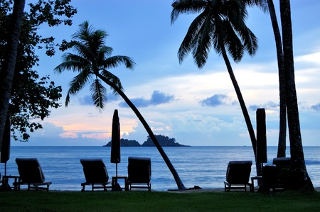 Beach during sunset with coconut palms, Koh Chang island, Thailand photo
