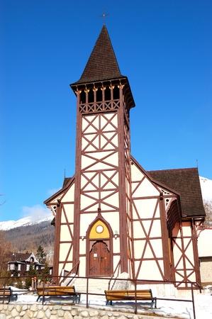 The old wooden Catholic church at ski resort, Tatranska Lomnica, Slovakia photo