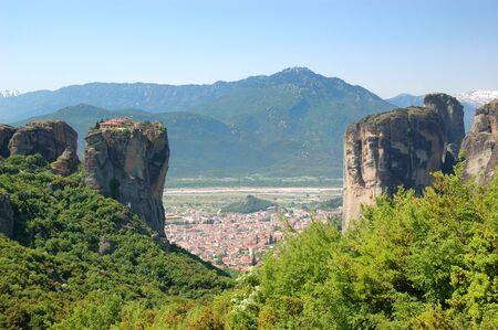 kalampaka: Kalampaka Town between two rocks with  Holy Trinity Monastery on a top, Meteora, Greece