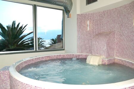 The jacuzzi in SPA at modern hotel, Thassos island, Greece Редакционное