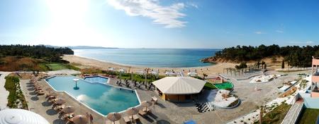 thassos: Panorama of swimming pools and bar by a beach at the luxury hotel, Thassos island, Greece