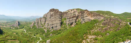 kalampaka: The panorama of Meteora with Holy Monastery of Varlaam on the top of cliff and Holy Monastery of St. Nicholas Anapausas and Kalampaka Town, Meteora, Greece