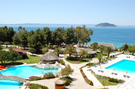 Swimming pools and bar  by a beach at the luxury hotel, Halkidiki, Greece
