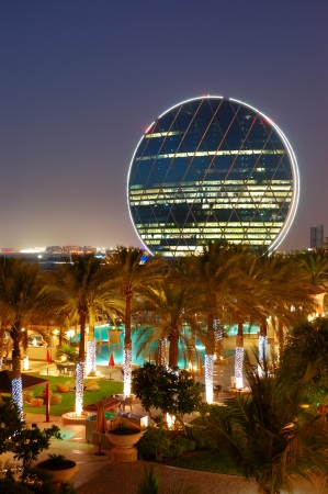 Night illumination in the luxury hotel and circular building, Abu Dhabi, UAE