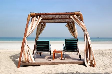 ajman: Hut on the beach of luxury hotel, Ajman, UAE Stock Photo
