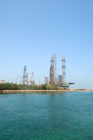 Oil drilling site at the shore, Sharjah, UAE photo