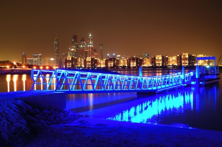 Night illumination on Palm Jumeirah man-made island, Dubai, UAE photo