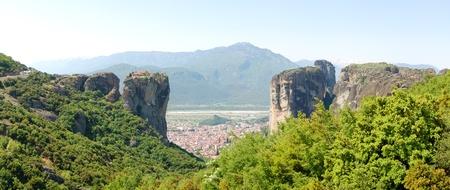 kalampaka: The panorama of Kalampaka Town between two rocks with Holy Trinity Monastery on a top, Meteora, Greece