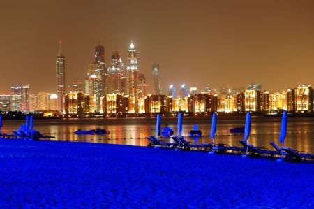 Night illumination of the luxury hotel beach on Palm Jumeirah man-made island, Dubai, UAE Stock Photo