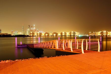 Night illumination of the luxury hotel on Palm Jumeirah man-made island, Dubai, UAE photo