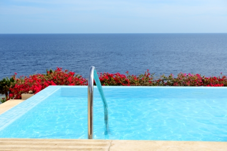 The infinity sea view swimming pool with jacuzzi at luxury hotel, Sharm el Sheikh, Egypt