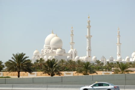 ABU DHABI, UAE - JUNE 11: The view from highway on Sheikh Zayed Grand Mosque on June 11, 2012 in Abu Dhabi, UAE. It is the largest mosque in UAE and eighth largest mosque in world