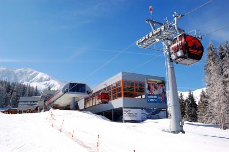 station ski: JASNA-MARCH 15: Cableway station in Jasna Low Tatras. It is the largest ski resort in Slovakia with 36 km of pistes, March 15, 2012 in Jasna, Slovakia