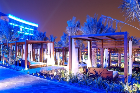 The huts near swimming pool at modern luxury hotel, Palm Jumeirah, Dubai, UAE