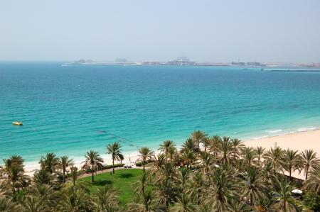 Beach with a view on Jumeirah Palm man-made island, Dubai, UAE photo