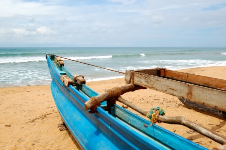 The traditional Sri Lankas boat for fishing on the beach photo