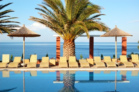 crete: Swimming pool by a beach at the modern luxury hotel, Thassos island, Greece