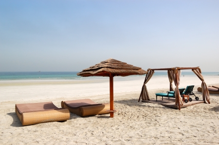 Beach with hut and sunbeds of the luxury hotel, Ajman, UAE Stock Photo - 18864149