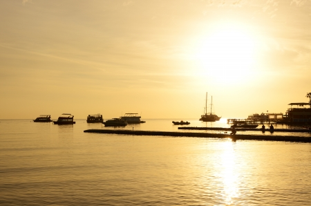 naama bay: Sunrise at Naama Bay, Red Sea and motor yachts, Sharm el Sheikh, Egypt Stock Photo