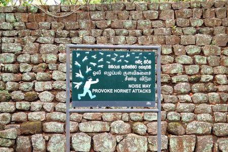 The sign  Noise may provoke hornet attack  in garden near Sigiriya  Lion photo