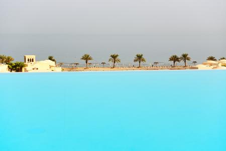 khaima: The view from swimming pool on a beach, Ras Al Khaima, UAE