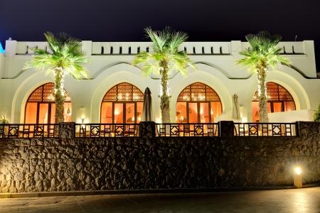 khaima: Night illumination of restaurant at luxury hotel, Ras Al Khaima, UAE Stock Photo