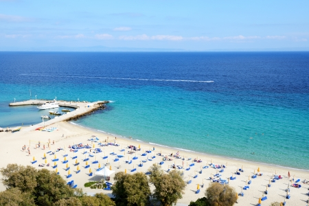 Sunbeds on a beach and turquoise water at the modern luxury hotel, Halkidiki, Greece photo