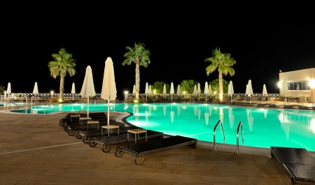 Swimming pool in night illumination, Halkidiki, Greece photo