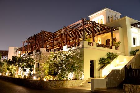 khaima: Night illumination of restaurant at luxury hotel, Ras Al Khaima, UAE Editorial