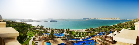 Panorama of beach with a view on Jumeirah Palm man-made island, Dubai, UAE Stock Photo