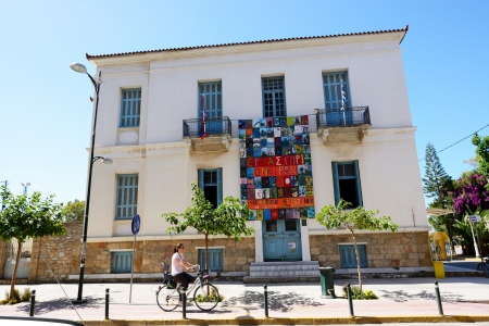 messinia: KALAMATA, GREECE - JUNE 7: The building with paintings and cyclist on June 7, 2013 in Kalamata city, Messinia, Greece. Up to 16 mln tourists is expected to visit Greece in year 2013.