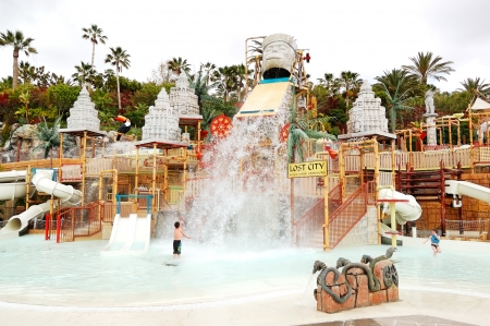 TENERIFE ISLAND, SPAIN - MAY 22: The kids playing in water attractions in Siam waterpark on May 22, 2011 in Tenerife, Spain. The Siam is the largest water theme park in Europe. Editorial