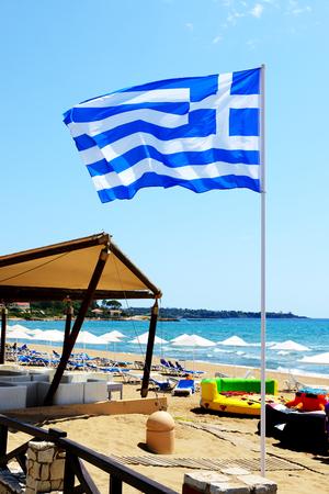 peloponnes: The Greek Flag on the beach, Peloponnes, Greece