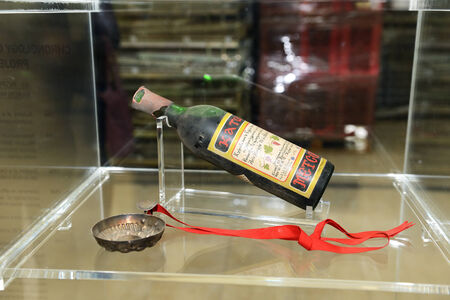 expected: METSOVO VILLAGE, GREECE-OCTOBER 11: The bottle of Katogi wine in the wine cellar produced in a Metsovo wine region on October 11, 2013 in Metsovo, Greece. Up to 12 mln tourists is expected to visit Greece in year 2013