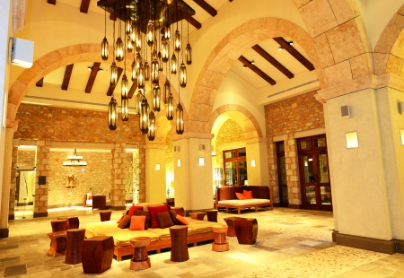 The large chandelier at lobby in luxury hotel in night illumination, Peloponnes, Greece