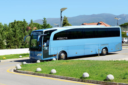 peloponnes: PELOPONNES, GREECE - JUNE 7: The modern bus for tourists transportation and driver are near hotel on June 7, 2013 in Peloponnes, Greece. Up to 16 mln tourists is expected to visit Greece in year 2013.