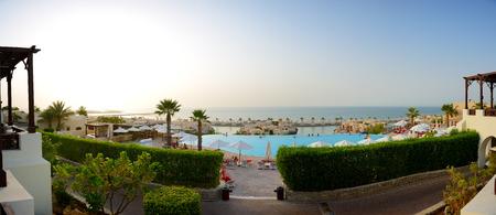 khaima: Panorama of the beach at luxury hotel in sunset, Ras Al Khaima, UAE Editorial